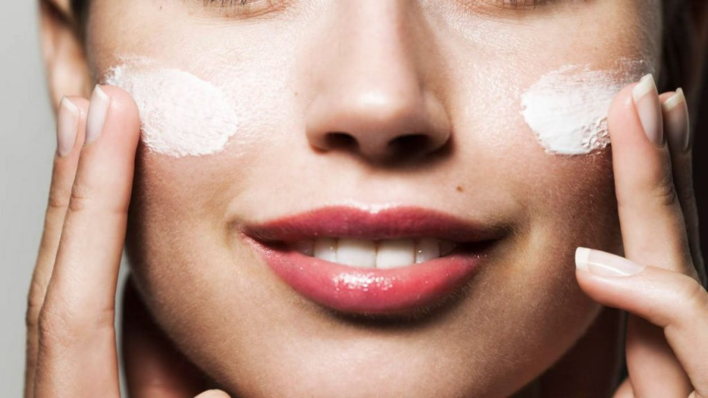 Woman Applying Skin Lightening Cream to Her Face